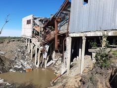 Building breaks in middle and collapses 10 metres as thawing permafrost no longer supports stilts Climate Warming, Sewage Treatment, Climate Change Effects, Going On A Trip, Greenhouse Gases, The Locals, Middle, House Styles, Moscow