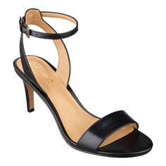 """A sleek, barely there ankle strap tops a deliciously simple dress sandal with a minimalist design. Padded footbed for all-day comfort. Leather upper. Man-made lining and sole. Imported. 2 3/4"""" mid heels."""
