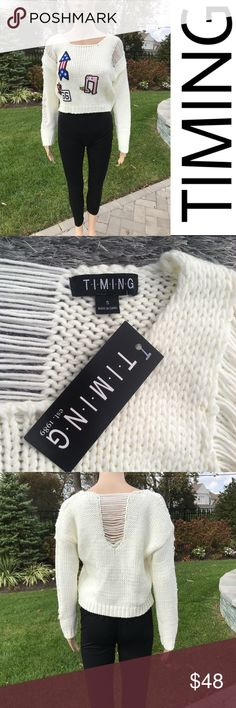 Timing cropped sweater with patches Timing cropped sweater with patches  New with tags  Perfect condition   Buy 2 items get 3rd half off , offering bundle discounts & accepting all reasonable offers Timing Sweaters Crew & Scoop Necks