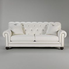 Sofa?  Hubby likes it...and it's tufted with nailhead trim - our favorites