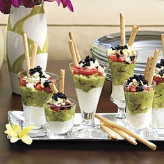10-Minute Appetizers | A tiny scoop of caviar adds bling to simple layers of sour cream, guacamole, and tomato. Mini Caviar Parfaits, looking glamorous in assorted shot glasses, are ready for guests in only minutes. | Mini Caviar Parfait | SouthernLiving.com