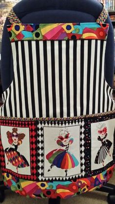 This is my sewing apron. I designed the layout so I could use several fabrics that was on the Loralie panel. The black and white stripes are by a different line of fabrics, along with the colorful diamonds print.