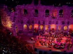 Yanni Live Videos His style is contemporary (sometimes even New Age), especially when compared with his mentors/inspirations, Anoushiravan Rohani and Javad Maroufi. He is probably most known for arranging and conducting the Yanni Live at the Acropolis concert, an op...