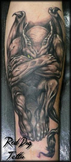Black and grey gargoyle tattoo.  Wonderfully done.