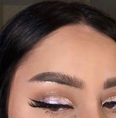 lilac shimmer eyelids, black eyeliner, glitter crease line, glitter under brow