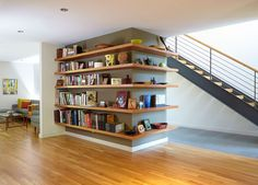 SHELVING IDEA - Shelves That Wrap Around Corners // Books have been confined to one side while decor pieces are displayed on the other…