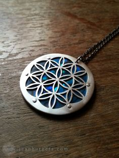 Hey, I found this really awesome Etsy listing at https://www.etsy.com/listing/180619193/large-blue-flower-of-life-pendant-on