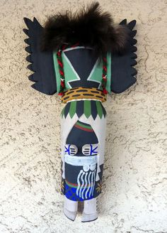 Territorial Indian Arts  Crow Mother Kachina is carved in the traditional wall hanger style by Hopi Indian artist Kevin Chavarria of First Mesa.
