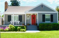 Gray house, red door, black shutters