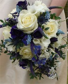 Avalanche roses with freesias, jasmine, delphiniums, muscari and veronica.