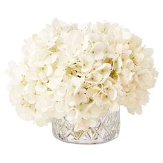 Set this lush faux floral arrangement on your dining table for a natural centerpiece, or place it on the mantel as a country-chic focal point.