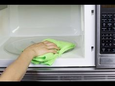 Photo about Hand with microfiber cleaning rag wiping inside of microwave oven. Image of microwave, oven, background - 28114442