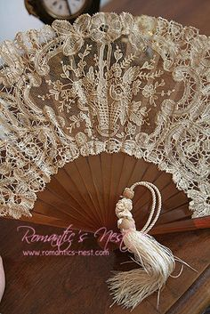 I adore lace fans....I have a small collection