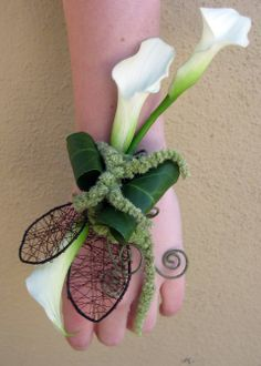 Non-traditional wrist corsages - mini calla lilly with grass and wire