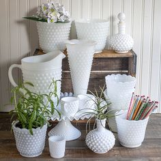 See my growing collection of milk glass in both hobnail and pretty white vases for an upcoming wedding.