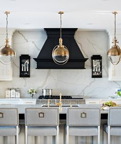 old style candle sconces and brass pendant lights, black hood.