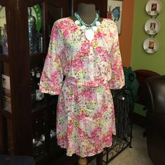 Lightweight Indian Cotton floral mini Wear rolled up or 3/4 sleeve. Button top and elasticized waist. Bossini Dresses Mini
