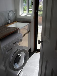 Beautiful country laundry with timber bench top and butler sink. Laundry Tubs, Laundry In Bathroom, Small Bathroom, Laundry Area, Bathroom Inspo, Fireclay Sink, Modern Laundry Rooms, Diy Outdoor Kitchen, Laundry Room Design