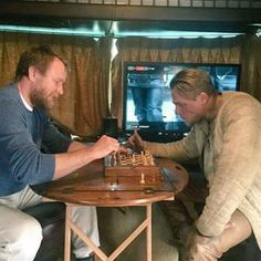 Charlie playing chess with Guy Ritchie (May 22)