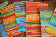 painted papers - i so love the stripes! these are painted on old book pages.