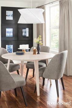 Designed for the way you dine, our Lowell round extension table can easily take your dinner party from four to six. Click to shop this room.