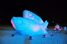 Made from discarded plastic water bottles.   As part of the UN Conference on Sustainable Development (Rio+20) an enormous outdoor installation of fish was constructed using discarded plastic bottles on Botafogo beach in Rio de Janeiro, Brazil. The sculptures are illuminated from the inside at night creating a pretty spectacular light show.