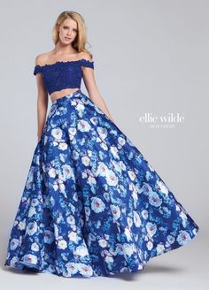 Ellie Wilde for Mon Cheri EW117068 is an off the shoulder two-piece Ellie Wilde prom gown in floral printed Mikado and Lace.