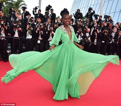 The 34-year-old actress twirled for photographers in the $26,000 Gucci creation with flora...