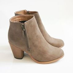 """The most perfect ankle booties to add to your Fall wardrobe! These Reneeze booties feature a small 3"""" heel, faux leather, and a side zipper for easy on and off closure. All man made material True to US size Imported"""
