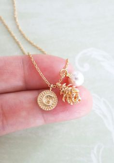 Tiny Gold pinecone pendant. Nature inspired. Personalised initial letter. (8mm) Swarovski white pearl dangle ( 6mm) Gold plated chain. ✦ Pinecone: