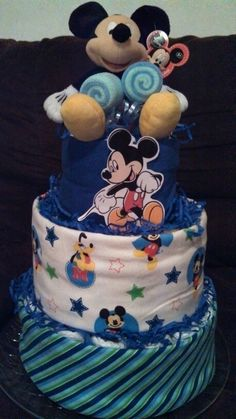 My 3 layer Mickey Mouse Diaper Cake incl...70 sz1 Huggies Diapers, 2 receiving blankets, 1 burp cloth, 2 lollipops (4 wash cloths, 2 spoons), Johnson & Johnson baby wash, powder, & shampoo, & Mickey Mouse plush toy.