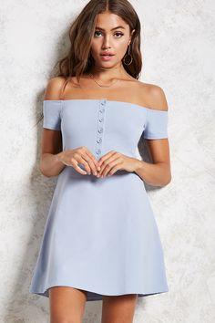 4ff614d611b A soft knit mini dress featuring an off-the-shoulder neckline