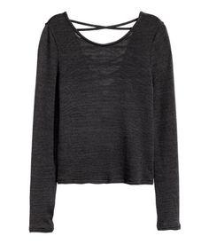 Black. Long-sleeved top in fine-knit, viscose-blend melange fabric with a slight…