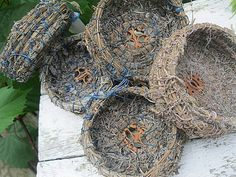 These little baskets are made entirely from the harvested lavender stalks that come out of my garden.Using the entire lavender stalk, stem and flowers both, small bundles are gathered and coiled into the basket shape. The center base features a walnut slice.  Waxed linen thread was used as the binding material.The thread is either blue or  a light lavender color. These little baskets have not been treated with any finish so that the natural lavender scent has a chance to shine through.
