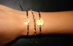Macrame bracelets with gold plated charms...