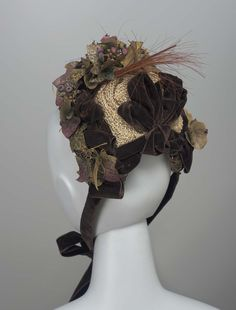 29b6384bc68 Beige and brown straw bonnet with brown velvet ribbons