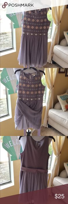 Very cute Jessica Simpsons girls dress. Size small This very pretty girls dress by Jessica Simpson. It is a sort of lavender grey color with embroidery on top, a fabric belt and a double layer skirt.. looks great with the girls coat I am also selling on my page.. 😃😃 Jessica Simpson Dresses Formal