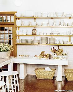At Martha's summer home on the coast of Maine, she displays her white dishes on open shelving.