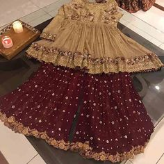 Golden and maroon embroidered baby girls sharara dress designs 2018 for wedding party Pakistani Mehndi Dress, Pakistani Fashion Party Wear, Pakistani Formal Dresses, Pakistani Wedding Outfits, Pakistani Dress Design, Bridal Outfits, New Stylish Dress, Stylish Dresses For Girls, Stylish Dress Designs