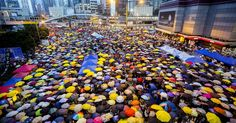 The pro-Democracy protesters who have brought the streets of downtown Hong Kong to a standstill for weeks commemorated one month since police fired teargas at protesters on Tues...