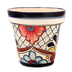 Decorated with hand-painted motifs and colorful floral designs this ceramic flower pot is crafted by Mexican artisan Armando Sobreyra. He applies the pot's decoration in the style of Talavera handicrafts. Painted Plant Pots, Painted Flower Pots, Ceramic Flower Pots, Ceramic Pots, Flower Pot Art, Flower Pot Design, Pebble Painting, Ceramic Painting, Pebble Art