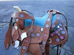 #saddle #western #barrel #pleasure #trail #cowboy #cowgirl #tooled #floral #basket #brown #black #horses #equine #equestrian #western #saddles #horses #barrelsaddles #barrelracing #barrelsaddleforsale #trailsaddles #traisladdleforsale #westernsaddles #westernsaddleforsale #pony #kids #child #youth #mini #blue #turquoise #rhinestone Barrel Saddles For Sale, Western Saddles For Sale, Western Horse Saddles, Pony Saddle, Cute Ponies, Black Horses, Barrel Racing, Leather Tooling, Pink Blue