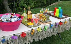 Hawaiian Luau Theme - this drinks table is the perfect example of a minimalist effect. A little bit of paper grass, some coloured flowers and cups, and your table is instantly recognisable as a Luau table. Aloha Party, Hawaiian Luau Party, Hawaiian Birthday, Luau Birthday, Adult Birthday Party, Birthday Party Themes, Adult Luau Party, Hawaiian Baby, Adult Party Themes