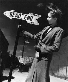 """André Kertész - """"Woman Holding a Sign"""", c. 1940. S)"""