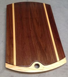 Wooden cutting board made with black walnut and hard maple $96