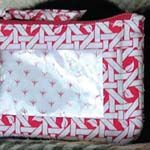 Free pattern for the All You Need Bag. Holds a few credit cards and a hidey hole for cash.