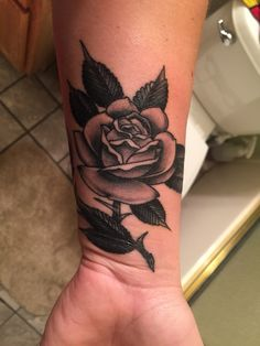 Black and grey rose on wrist
