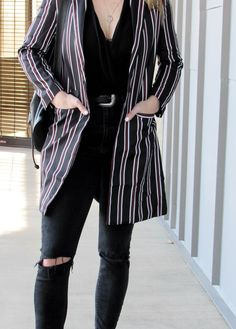 Black ripped jeans outfit for fall with long striped blazer. #black #ripped #jeans #denim #outfit #fall