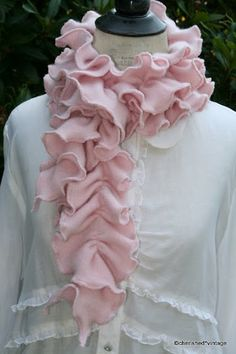 ruffle scarf-DIY by using a knit fabric, stretch fabric as you sew edges, sew a loose straight seam down middle, pull seam to create ruffles.