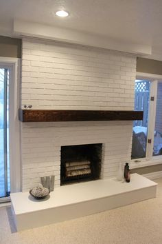 "Basement Fireplace with 80"" hidden projector screen"